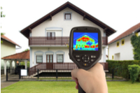 Bilde av hus med fotografering med termograf kamera - Takstmann Erik Laursen